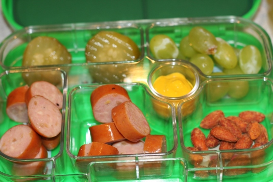 pickles, grapes, apple sausage with honey mustard dip and almonds